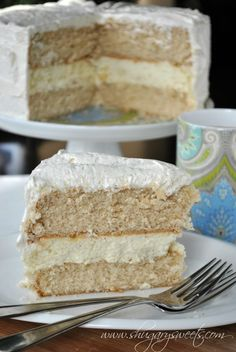 Eggnog Cheesecake Cake- two layers of spice cake (from scratch!) with a creamy layer of cheesecake topped with eggnog frosting!