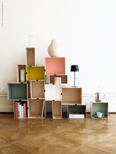 I love this use of plywood PRÄNT boxes, as seen on IKEA's Livet Hemma blog. They've been painted inside at random, then joined together with binder clips to create a modular shelving unit. Nice!