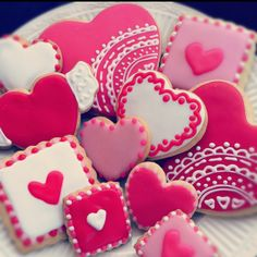 Valentines Day sugar cookies decorated with glaze icing. By Blue Sugar Cookie Co. www.Facebook.com/bluesugarcookieco