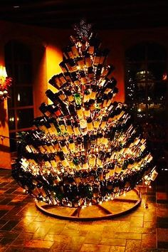 Christmas wine bottle tree. I could do this!!