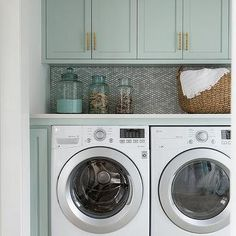 Gray Green Laundry Room Cabinets with Mosaic Tiles