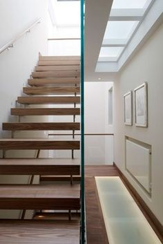 timber open tread stair - glass wall