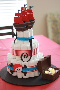 Ahoy - here's a cute pirate baby shower diaper cake. Diaper Shower, Baby Shower Diapers, Baby Shower Cakes, Baby Shower Themes, Baby Boy Shower, Baby Shower Decorations, Baby Shower Gifts, Baby Gifts, Pirate Baby Shower Ideas