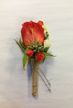 Rustic orange rose boutonniere with eucalyptus and berry accents and burlap ribbon stem wrap. Boutonniere by Seasonal Celebrations. http://www.seasonalcelebrations.com