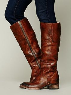 FREEBIRD By Steven Wrangler Tall Boot   Distressed leather tall boot with Western-style stitch design. Mini stud embellishment at each bottom side of foot. Leather sole.   *By FREEBIRD by Steven