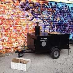 The Bread Companion's moving, micro bakery, complete with everything you need for making bread - a trailer with a wood fired oven, sink and space for wood storage and ingredients