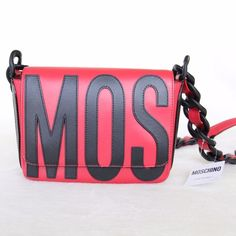 """NWT Moschino Large Chain Red Crossbody Purse This chunky chain crossbody purse makes a chic bold statement! ✨It has a fold-over top with snap closures. ✨The purse is 100% leather abc the chains are 100% plastic. ✨Imperfections: Slight scratches on the magnetic snap closures and a small black dot by the """"N"""" on the back side. Hardly noticeable. Purchased that way. ✨About $1150 w/ tax ✨Excellent condition! ✨Comes with dust bag Moschino Bags Crossbody Bags"""