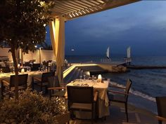 An evening at Mythos of the Sea Restaurant offers the freshest flavors of the sea and the vibrant colors of the sun setting along… Restaurant Offers, Palace, Vibrant Colors, Sea, Sunset, Vivid Colors, Palaces, The Ocean, Sunsets