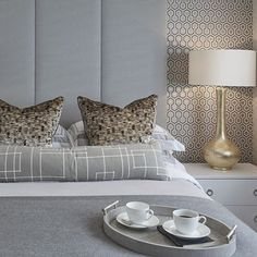 Sophie Paterson Interiors Funky guest bedroom at the Esher project with lots of retro geometric prints in a grey and gold colour scheme #bedroom #headboard #luxuryint...