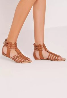 The gladiator sandal is THE ultimate summer staple and is forever in fashion! So show off those tootsies in style in these gorge gladiator sandals. In a woven style with buckle detail and in ever stylish tan, pair with your fave summer dres...