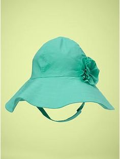 Floppy hat in turquoise with flower accent.
