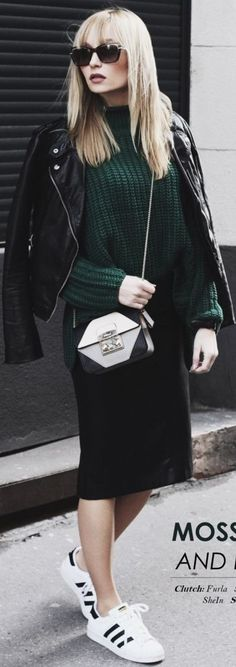 Black Sunnies, BlackBiker Jacket, Green Chunky Sweater, Black Midi Skirt, Black And White Bag, Back And White Sneakers | Sporty Chic Winter Street Style | Chloe From The Woods
