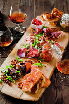 Meat platter - Coppa, black forest and prosciutto shavings staked with biltong served with pickled mushroom & calamata black olives, a garlic ciabatta skewer and homemade orange and chilli preserve