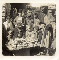 "Bread seller, Damascus ca. 1910. Street cry ""Ya Karim"" Oh generous/bountiful (God)"
