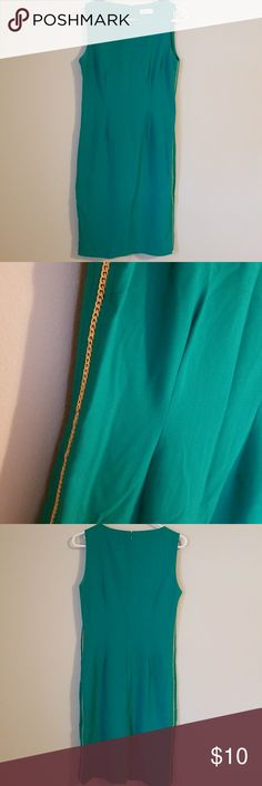 Calvin Klein Dress Used once, (bodycon style) holiday green, knee-length dress with a gold-braided detail accent down the sides. Calvin Klein Dresses Midi