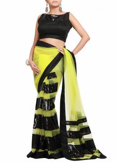 Florescent green net saree with black blouse by Kalki