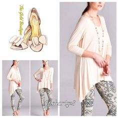 Ivory V-Neckline Tunic A must have for every wardrobe. Stylish Ivory tunic top. Featuring ,-Neckline & Asymmetrical hem. Perfect for pairing with leggings. Made of Rayon/Spandex blend. Leggings sold in a separate listing. Very stretchy fabric.  Sizes Available S/M & M/L. The Gold Boutique Tops Tunics