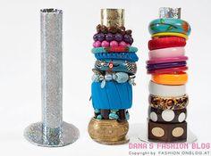 buena idea...tubos de cocina y cd reciclados