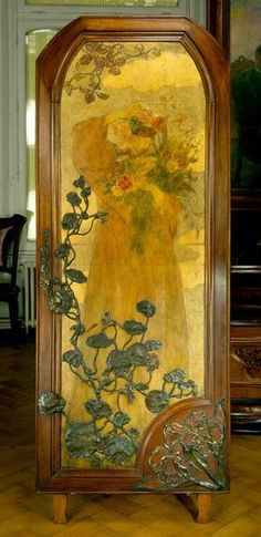 Art Nouveau door panel c1900 by Victor Prouvé. Hammered, repoussé, pyrograve, gilt and painted wood with bronze decoration. Ecole de Nancy - cuir Prouvé