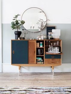 Love this midcentury look? A simple round IKEA mirror looks deceptively elegant paired with a vintage wooden sideboard. The secret to mastering this mix is to style the countertop with...
