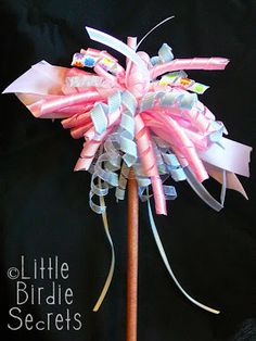 We're sure lots of you out there already know how to make those curled ribbon hair bows, but we thought we'd put a princess spin on it. Per...