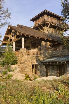 Hewn timber and local stone were used to construct this Montana residence http://www.onsitemanagement.com/