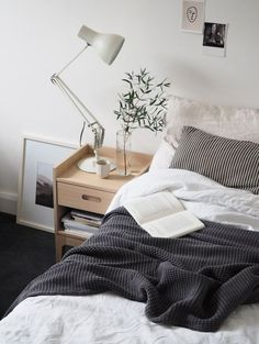 Light, simple bedroom style. White bed linen, Anglepoise lamp, and greenery. A simple guest bedroom update with Heal's Morten collection