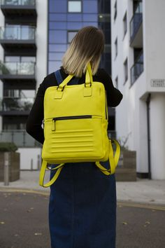 """Yellow minimal, two in one unisex backpack-rucksack. It's divided into two separate sections. 100% Italian leather, perfectly fits 15"""" Macbook, made in Europe."""
