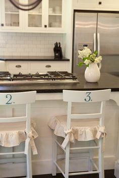Painted numbers on furniture.  I like!  The little slip covered seats are amazing too...nice detailed ticking stripe trim:-)