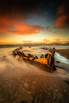 ponderation: Sun Beam V by Marek Biegalski, old wooden boat, weathered, sunrise, sunset, beach, water, decay, beauty of Nature, photo