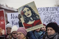 Kosovo - Women hold posters as they take part in a march for women's rights and freedom in solidarity with the march organized in Washington, on January 21, 2017 in Pristina. Hundreds of thousands of protesters spearheaded by women's rights groups are set to converge on Washington to send a defiant message to America's new president, Donald Trump.