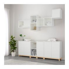 EKET Storage combination with legs IKEA Hide or display your things by combining open and closed storage. 82 5/8x13 3/4x82 5/8 ""