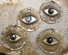 Bronze Protection Eye and Rose Cut Sapphire Coin. $26.00, via Etsy.  I might be in love with this woman OMG everything she makes is beautiful !!