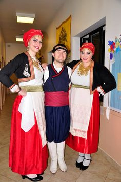 Three dancers in traditional folk costumes of the island of Crete before the 2nd segment of the 2014 annual Taverna Night.