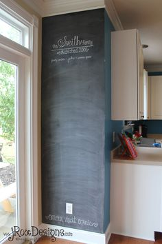 Chalkboard Accent Wall by the kitchen door! Use skinny white tape to make a calender on it for everyone to use!