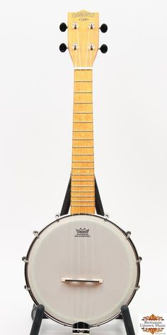 From Gretsch's Roots Collection, this is a very gently used concert scale banjo ukulele featuring a maple neck/fingerboard and plywood rim/resonator. Outfitted with Grover geared tuners, 12 brackets, all nickel hardware. Archtop tonering gives this banjo a great clear tone. Complete with a soft shell gig bag.