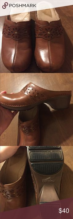 Danskos Nice pair of danskos in size 39. Caramel color with etched design.  minimal wear...ton of miles left in these well made shoes! Dansko Shoes