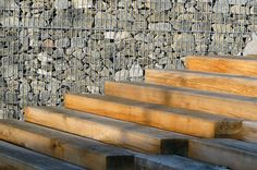 Wooden stairs and slate schist gabions at Bottière Chênaie Eco-district in Nantes, France by Atelier des Paysages Bruel-Delmar