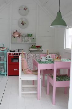 Inside The most amazing little DIY Play Shed for Girls! I love that pink furniture