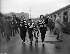 This picture appealed to my love of trains as well as football, with Fulham fans at London's old Addison Road station in 1957 to catch a spe...