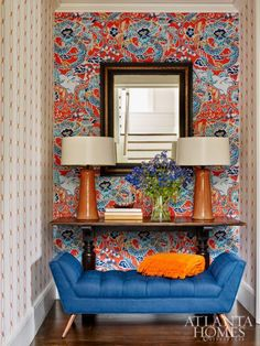 Thibaut's Imperial Dragon and Madeira Chain wallpapers create interest in this tiny, windowless vestibule.