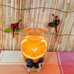 Sweet blueberries and tart orange is a fantastic combination of flavours and colours! Drinking Jars, Drinking Water, Orange Wheels, Infused Waters, Spa Water, Pomegranate Seeds, Lemon Lime, Blueberries, Tart