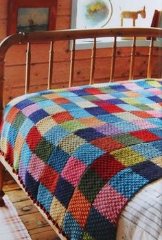 Great idea: 'For this blanket, Jane used double moss stitch and knit five 'scarves' that were then sewn into one big blanket.'....crochet scarves and do the same......