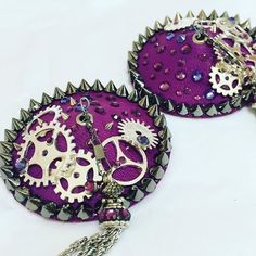 Something a little different for today. #steampunk nipple covers. #burlesque #nippletassels #showgirl #beaurockscostumier #cogs #spikes #purple#costume #costumier #burlesque #showgirl #custom #design #costumedesign #bespoke #swarovski #handmade #imadethis #sewing #crafting #beaurockscostumier #nippletassels #pasties #rhinestoning #corset #ostrich #ostrichboa