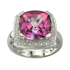 My birthstone in PINK!!!! MAN that's obnoxious!!  .. LOL  pink topaz and diamond ring