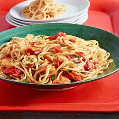 """Try Rachael Ray's Venetian-Style Spaghetti all'Arrabbiata. Arrabbiata (""""angry"""") indicates a spicy, garlicky sauce prepared in a hurry. Rach says: """"This pasta is delicious as is, but bump up the protein with grilled shrimp or calamari, especially if you're entertaining."""""""