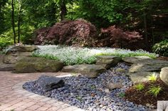 Designed and installed by Blue Ridge Landscaping Outdoor Spaces, Outdoor Living, Outdoor Decor, Mexican Beach Pebbles, Mi Photos, Stone Landscaping, Drought Tolerant Landscape, Garden Architecture, Flagstone