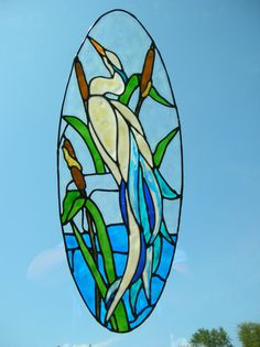 Heron in a stream with cat tails stained glass window Cling. $12.25, via Etsy.