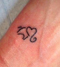 Small heart elephant tattoo