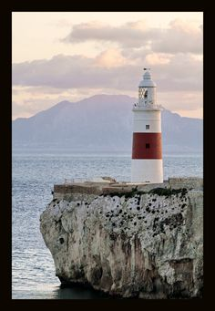 Gibraltar rock tours  Europa point with Trinity Lighthouse and North Africa Morocco across the straits of Gibraltar.